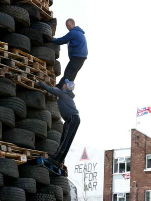 Photographer ?Matt Mackey - Presseye.com 10th July 2015  Bonfire builders at Mount Vernon in North Belfast.