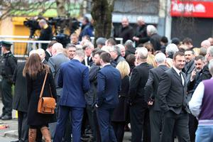 The funeral for prison officer Adrian Ismay who died following a dissident republican bomb attack is underway in Belfast.