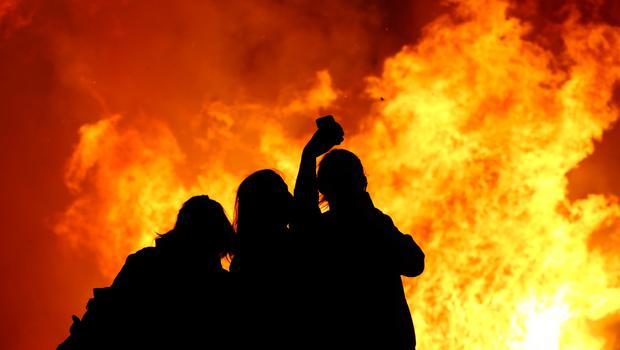 A group of women take a selfie as the Ballymacash bonfire burns in Lisburn. Pic: William Cherry/Presseye.