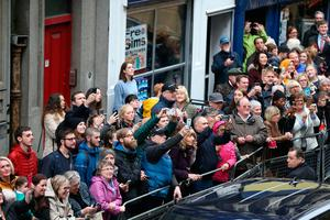 The crowd cheer the arrival of the Duke of Cambridge for his visit  to Inspire, a charity and social enterprise which focuses on promoting wellbeing for all across the island of Ireland, as part of his tour of Belfast. PRESS ASSOCIATION Photo. Picture date: Wednesday October 4, 2017: Niall Carson/PA Wire