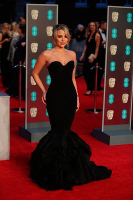 British celebrity Lydia-Rose Bright poses on the red carpet upon arrival at the BAFTA British Academy Film Awards at the Royal Albert Hall in London on February 18, 2018. / AFP PHOTO / Daniel LEAL-OLIVASDANIEL LEAL-OLIVAS/AFP/Getty Images