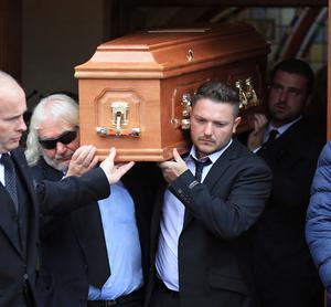 PACEMAKER, BELFAST, 11/7/2018: William Dunlop's uncle, Jim and his cousin Gary, the son of Joey, carry his coffin at the funeral at Garryduff Presbyterian church outside Ballymoney today. Dunlop was killed in a crash during practice for the Skerries 100 last Saturday. PICTURE BY STEPHEN DAVISON
