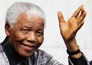 LONDON - JUNE 26:  Nelson Mandela leaves the Intercontinental Hotel after a photoshoot with celebrity photographer Terry O'Neil on June 26, 2008 in London, England. Mandela is in London in advance of the 46664 concert being held at Hyde Park on Friday the 27th June to celebrate Nelson Mandela's 90th Birthday.  (Photo by Chris Jackson/Getty Images)