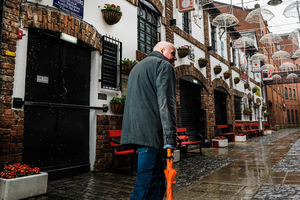 One of Belfast's best-known publicans, Willie Jack, walks past his Duke of York bar in Belfast. Pic Elaine Hill