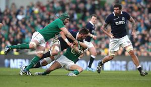 DUBLIN, IRELAND - FEBRUARY 02: Ryan Wilson of Scotland is tackled by Dan Tuohy (L) and Luke Marshall during the RBS Six Nations match between Ireland and Scotland at the Aviva Stadium on February 2, 2014 in Dublin, Ireland.  (Photo by David Rogers/Getty Images)