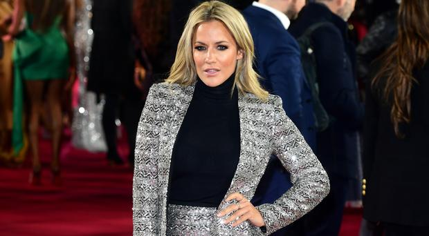 Caroline Flack has become synonymous with the ITV2 show (Ian West/PA)