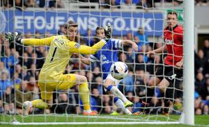 Everton's Kevin Mirallas scores their second goal past Manchester United goalkeeper David De Gea during the Barclays Premier League match at Goodison Park, Liverpool.