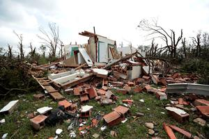 SHAWNEE, OK - MAY 20:  A home sits damaged after a tornado moved through the area May 20, 2013 near Shawnee, Oklahoma. A series of tornados moved across central Oklahoma May 19, killing two people and injuring at least 21. (Photo by Brett Deering/Getty Images)