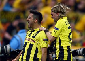 LONDON, ENGLAND - MAY 25:  Ilkay Gundogan of Borussia Dortmund (L) celebrates with team-mate Marcel Schmelzer after scoring a goal from the penalty spot during the UEFA Champions League final match between Borussia Dortmund and FC Bayern Muenchen at Wembley Stadium on May 25, 2013 in London, United Kingdom.  (Photo by Alex Grimm/Getty Images)