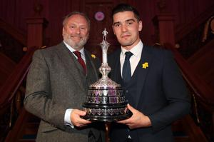 Jimmy Callacher receives the Ulster Footballer of the Year trophy for 18/19 from Stephen Duncan (left), regional director for sponsors Purple Bricks