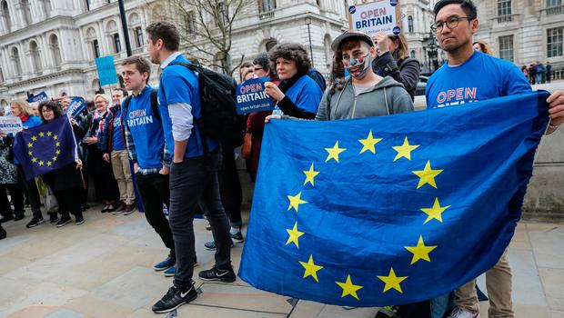 LONDON, ENGLAND - MARCH 29: Protesters hold flags of Europe and placards during a demonstration outside of Downing Street on March 29, 2017 in London, England. Later today British Prime Minister Theresa May will address the Houses of Parliament as Article 50 is triggered and the process that will take Britain out of the European Union will begin. (Photo by Jack Taylor/Getty Images)