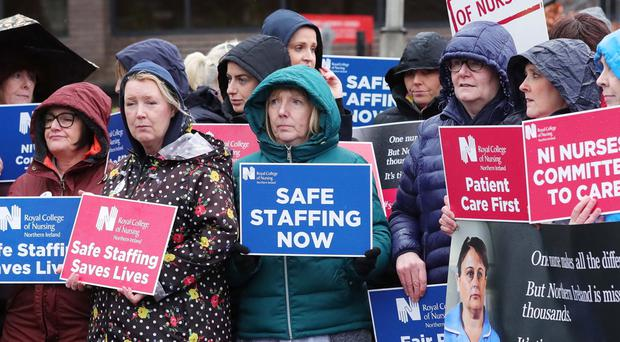 RCN workers at Belfast City Hospital as part of continuing strike action in the health service. Press Eye