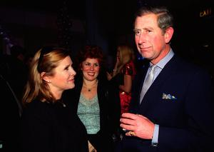File photo dated 08/12/99 of Carrie Fisher (left) with the Prince of Wales, as the actress has died at age 60, her daughter's publicist said. PRESS ASSOCIATION Photo. Picture date: Tuesday December 27, 2016. See PA story DEATH Fisher. Photo credit should read: Fiona Hanson/PA Wire