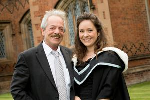 Olivia McIntyre celebrates her graduation success from Queen's University Belfast. Olivia, pictured here with her dad John McIntyre, graduated with a degree in French and Spanish.
