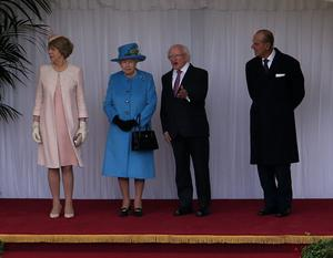 (left to right) Sabina Higgins, wife of the Irish President, Queen Elizabeth II, the President of Ireland, Michael D Higgins and Prince Philip inspect the guard at Windsor Castle, Berkshire during the first State visit to the UK by an Irish President
