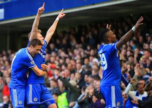 LONDON, ENGLAND - MARCH 22:  Andre Schurrle of Chelsea celebrates scoring his second goal with Nemanja Matic and Samuel Eto'o of Chelsea during the Barclays Premier League match between Chelsea and Arsenal at Stamford Bridge on March 22, 2014 in London, England.  (Photo by Richard Heathcote/Getty Images)