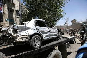 Security forces carry the wreckage of car near the site of a suicide attack where German Embassy is located in Kabul, Afghanistan, Wednesday, May 31, 2017.  Photos: Rahmat Gul, AP