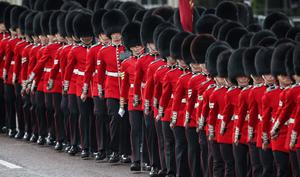 LONDON, ENGLAND - MAY 08:  Members of The Guards march on The Mall ahead of the State Opening of Parliament  on May 8, 2013 in London, England. Queen Elizabeth II will unveil the coalition government's legislative programme in a speech delivered to Members of Parliament and Peers in The House of Lords today. Proposed legislation is expected to be introduced on toughening immigration regulations, capping social care costs in England and setting a single state pension rate of 144 GBP per week.  (Photo by Peter Macdiarmid/Getty Images)