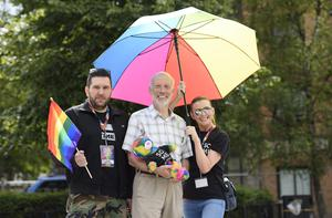 PRESS RELEASE IMAGE  1/8/15: Justice Minister David Ford showing his support for the LGBT community at Belfast's Pride Festival with Roisin Lavery, Equality Commission and Sean O'Neill, Festival organiser. Picture: Michael Cooper