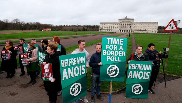 Sinn Fein activists calling for a border poll, stage a demonstration outside Parliament Buildings, Stormont, Belfast, ahead of the UK leaving the European Union at 11pm on Friday. PA Photo. Picture date: Friday January 31, 2020. See PA story POLITICS Brexit Ireland. Photo credit should read: Brian Lawless/PA Wire