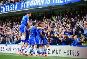 LONDON, ENGLAND - MARCH 22:  Andre Schurrle of Chelsea celebrates scoring his second goal with Nemanja Matic, Eden Hazard, Samuel Eto'o, Oscar, Branislav Ivanovic of Chelsea during the Barclays Premier League match between Chelsea and Arsenal at Stamford Bridge on March 22, 2014 in London, England.  (Photo by Richard Heathcote/Getty Images)
