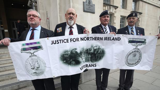 Veterans (left to right) Alan Barry, Roy Brinkley, Michael Burke and Peter White protesting outside the MoD in London against investigations into troops who fought in during the Troubles in Northern Ireland (Yui Mok/PA)