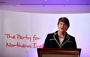 BELFAST, NORTHERN IRELAND - DECEMBER 17:  The new DUP leader Arlene Foster addresses the media and party colleagues at the Park Avenue hotel after the Democratic Unionist Party electoral college meeting on December 17, 2015 in Belfast, Northern Ireland. Arlene Foster succeeds Peter Robinson and becomes the first female leader of the Democratic Unionist Party. No other nominations were put forward for the role of leader. Mrs Foster will also be appointed as the new Northern Ireland first minister in the coming weeks. The former Ulster Unionist Party member has enjoyed a rapid rise through the ranks of the DUP following her defection in 2004, twice standing in as temporary first minister for Peter Robinson in times of personal and political crisis. The DUP remain the largest political party within the provinces' Executive government.  (Photo by Charles McQuillan/Getty Images)