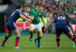 Brian O'Driscoll of Ireland runs at the french defence during the RBS Six Nations match between France and Ireland at Stade de France on March 15, 2014 in Paris, France.  (Photo by Julian Finney/Getty Images)