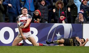 Jacob Stockdale and the Ulster fans share in the delight of his try.