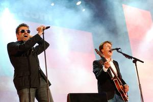 Paul McCartney  with George Michael performing during the LIVE8 Concert in Hyde Park, London, as George Michael has died at the age of 53 from suspected heart failure. 11/05/11
