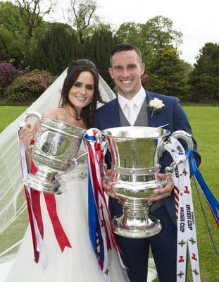 Andy Waterworth with wife Lisa on their wedding day with the title and Irish Cup. Photo: Mark Marlow/Pacemaker