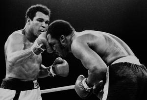 In this Oct. 1, 1975, file photo, Muhammad Ali's throws a right at Joe Frazier in the 13th round in their title bout in Manila, Philippines. Ali, the magnificent heavyweight champion whose fast fists and irrepressible personality transcended sports and captivated the world, has died according to a statement released by his family Friday, June 3, 2016. He was 74. (AP Photo/FILE)