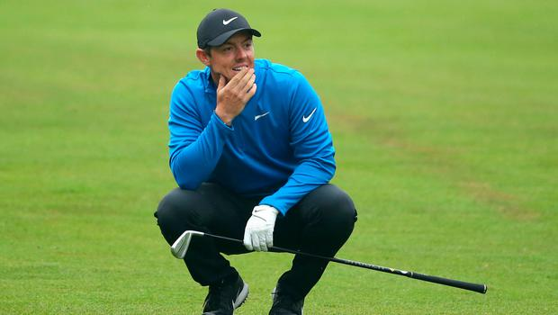 Pitch perfect: Rory McIlroy waits to play his shot on the 12th in the BMW PGA Championship at Wentworth