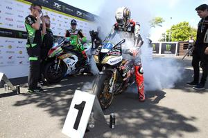 PACEMAKER, BELFAST, 6/6/2019: Peter Hickman (Trooper Beer Triumph) celebrates winning the 2nd Supersport TT today with runner up Dean Harrison (Silicone Kawasaki) and third placed James Hillier (Quattro Plant Kawasaki). PICTURE BY STEPHEN DAVISON