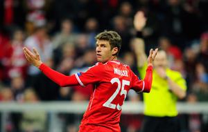 MUNICH, GERMANY - APRIL 09:  Thomas Mueller of Muenchen reacts during the UEFA Champions League quarter-final second leg match between FC Bayern Muenchen and Manchester United at Allianz Arena on April 9, 2014 in Munich, Germany.  (Photo by Lennart Preiss/Bongarts/Getty Images)