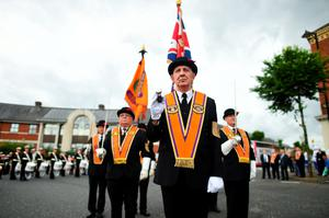BELFAST, NORTHERN IRELAND - JULY 12: The leading party of Orangemen stand to attention as they wait for the beginning of the annual Orange march on July 12, 2016 in Belfast, Northern Ireland. The Orange marches and demonstrations celebrate the Battle of the Boyne in 1690 when the Protestant King William of Orange defeated the Catholic King James II on the banks of the river Boyne. (Photo by Charles McQuillan/Getty Images)
