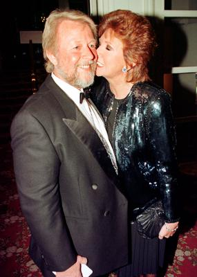 Cilla Black and her husband Bobby attending the Royal Television society awards ceremony at The Grosvener in London in 1997. Cilla Black has died at her home in the south of Spain, according to reports. PRESS ASSOCIATION Photo. Issue date: Sunday August 2, 2015. See PA story DEATH Black. Photo credit should read: Neil Munns/PA Wire