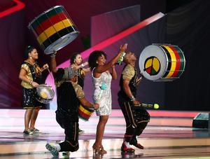 COSTA DO SAUIPE, BRAZIL - DECEMBER 06:  Margareth Menezes and Olodum perform on stage after the Final Draw for the 2014 FIFA World Cup Brazil at Costa do Sauipe Resort on December 6, 2013 in Costa do Sauipe, Bahia, Brazil.  (Photo by Clive Mason/Getty Images)