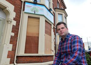 Pacemaker Press Belfast 14-04-2016: A man in his 40s has been arrested after the windows of a suicide prevention charity's offices in north Belfast were smashed during an attack. The incident happened at the offices of Public Initiative For Prevention of Suicide and Self Harm (PIPS) on the Antrim Road on Wednesday night. PIPS Chief Executive Brian Maguire pictured outside the office. Picture By: Pacemaker.