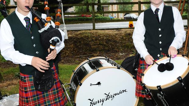 Young Piper and Drummer of Harry Ferguson Memorial band warm up in Derriaghy
