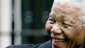 LONDON - NOVEMBER 26: Former President of South Africa Nelson Mandela smiles as he leaves Downing Street November 26, 2004 in London, England.   (Photo by Ian Waldie/Getty Images)         *** Local Caption *** Nelson Mandela