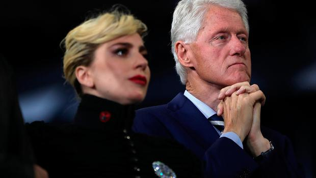 RALEIGH, NC - NOVEMBER 08:  Former U.S. President Bill Clinton (R) and musician Lady Gaga look on as Democratic presidential nominee former Secretary of State Hillary Clinton during a campaign rally at North Carolina State University on November 8, 2016 in Raleigh, North Carolina. The midnight rally followed Clinton campaigning in Pennsylvania, Michigan and North Carolina in the lead up to today's general election.  (Photo by Justin Sullivan/Getty Images)