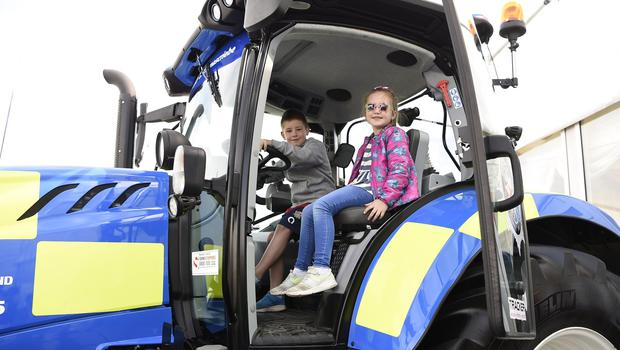 15/5/19: Kids enjoy sitting in a PSNI tractor at the Balmoral Show. Picture: Michael Cooper