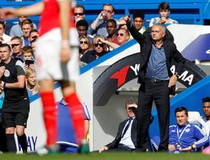 Chelsea's Portuguese manager Jose Mourinho (R) gestures during the English Premier League football match between Chelsea and Arsenal at Stamford Bridge in London on September 19, 2015. AFP PHOTO / IAN KINGTON  RESTRICTED TO EDITORIAL USE. No use with unauthorized audio, video, data, fixture lists, club/league logos or 'live' services. Online in-match use limited to 75 images, no video emulation. No use in betting, games or single club/league/player publications.IAN KINGTON/AFP/Getty Images
