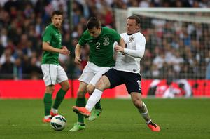 England's Wayne Rooney (right) and Republic of Ireland's Seamus Coleman battle for the ball during the International Friendly match at Wembley Stadium, London. PRESS ASSOCIATION Photo. Picture date: Wednesday May 29, 2013. See PA story SOCCER England. Photo credit should read: John Walton/PA Wire. RESTRICTIONS: Use subject to FA restrictions. Editorial use only. Commercial use only with prior written consent of the FA. No editing except cropping. Call +44 (0)1158 447447 or see www.paphotos.com/info/ for full restrictions and further information.