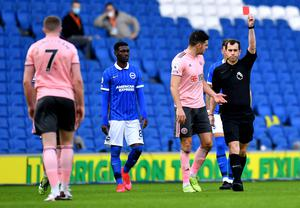 John Lundstram (left) receives a red card from referee Peter Bankes(Glyn Kirk/PA)