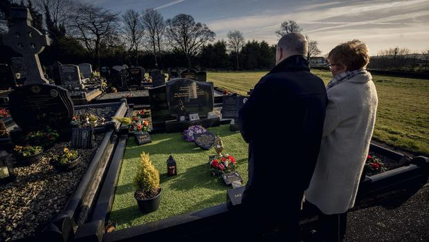 Breege and Stephen Quinn parents of Paul Quinn at Paul's grave in Cullyhanna on February 5th 2020 (Photo by Kevin Scott for Belfast Telegraph)