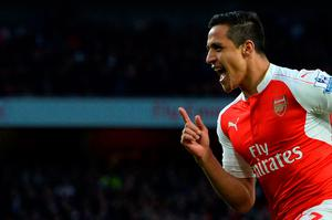 Arsenal's Chilean striker Alexis Sanchez celebrates scoring the opening goal during the English Premier League football match between Arsenal and West Bromwich Albion at the Emirates Stadium in London on April 21, 2016.  / AFP PHOTO / GLYN KIRK / RESTRICTED TO EDITORIAL USE. No use with unauthorized audio, video, data, fixture lists, club/league logos or 'live' services. Online in-match use limited to 75 images, no video emulation. No use in betting, games or single club/league/player publications.  / GLYN KIRK/AFP/Getty Images