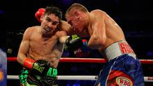 Michael Conlan punches Vladimir Nikitin during their featherweight bout at Madison Square Garden on December 14, 2019 in New York City. (Photo by Al Bello/Getty Images)