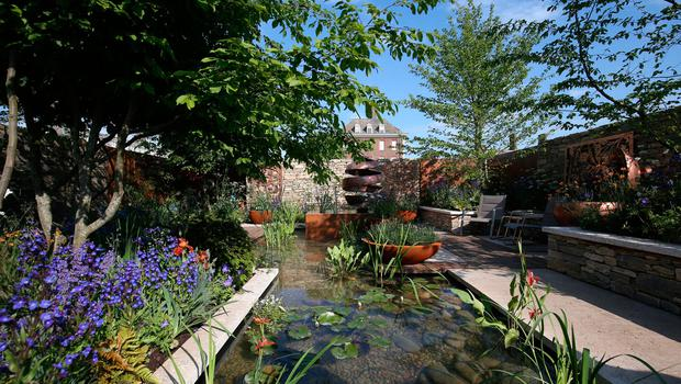 The Silent Pool Gin garden at the RHS Chelsea Flower Show at the Royal Hospital Chelsea, London. PRESS ASSOCIATION Photo. Issue date: Tuesday May 22, 2018. Photo credit should read: Jonathan Brady/PA Wire